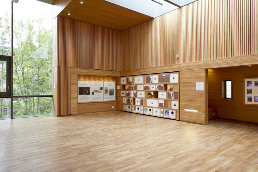 Interior of Scottish Story Telling Centre, Edinburgh. Wood panelled studio with pull-out divider/shelves in wood